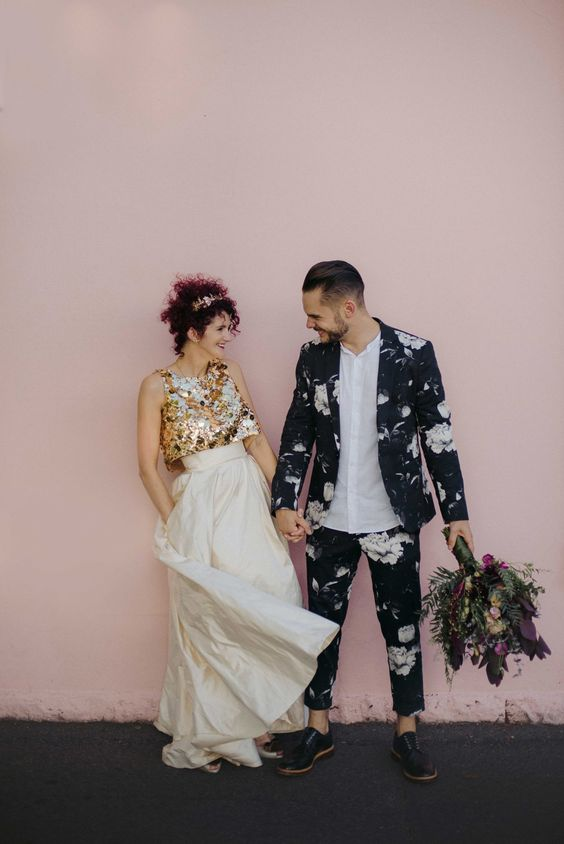 unique bride in gold two-piece wedding dress + groom in floral suit