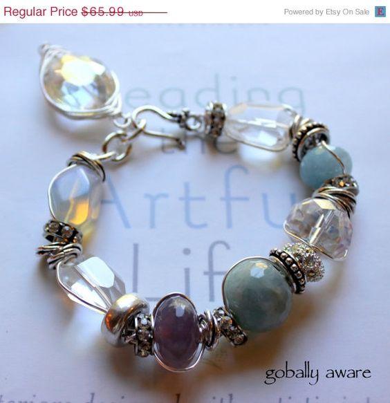ON SALE globally aware wire wrapped opal crystal quartz aquamarine amethyst crystal pandora charm bracelet. $56.09, via Etsy.