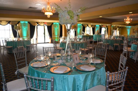 Sunday Daytime Wedding Reception With Tiffany Blue Satin Overlays Teal Uplighting And Silver Chiavari Chairs Flower Arrangements By Floral Product