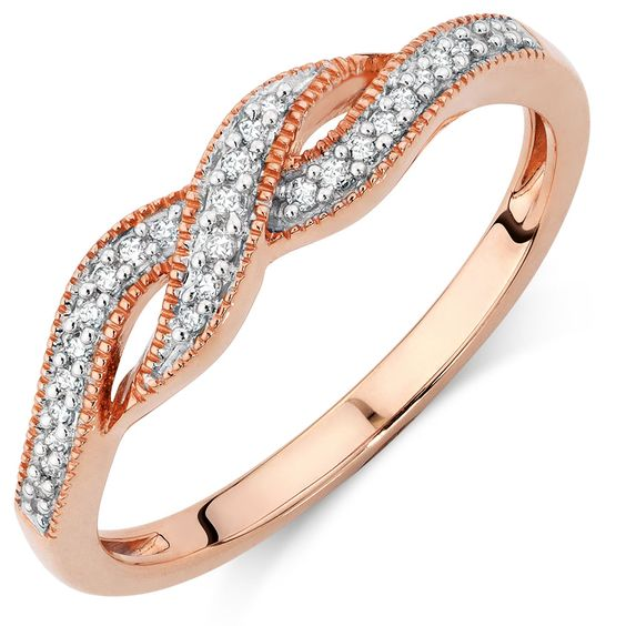 Spoil the one you love with this superb diamond and 10kt rose gold ring. Dainty round brilliant diamonds are claw-set in the twists of a timeless design that will bring out your inner shine.