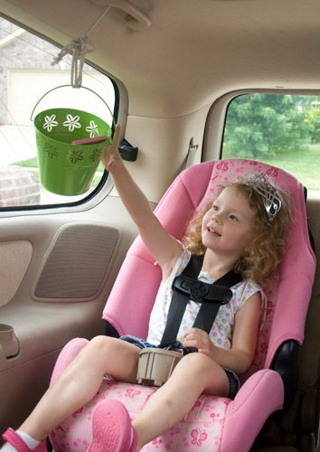 bucket pullley system for traveling with kids - the perfect way to pass back snacks and travel activities for kids