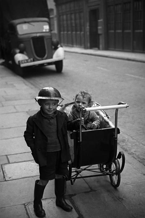 George Rodger - Steel helmets were worn by all who could get them during the Blitz of World War ll,1940
