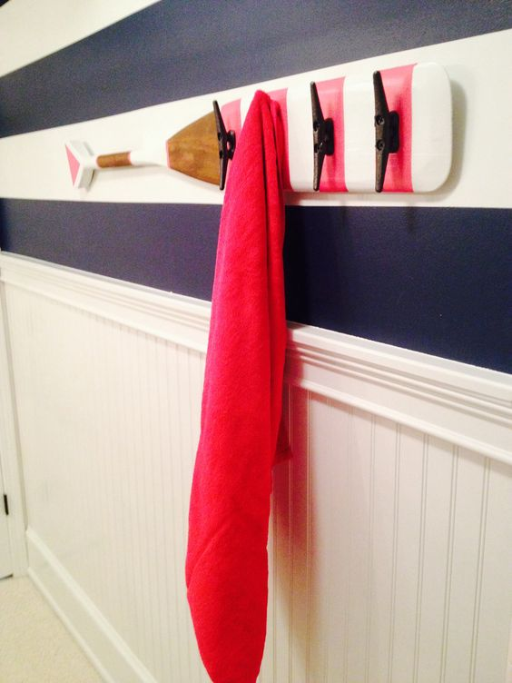 Nautical theme Bathroom  Striped wall paper, painted stripes,  added bead board wainscot and trim, modernized fixtures, framed mirror, custom wire basket lights, custom rope hanging shelves, custom printed shower curtain, custom paddle with boat cleat towel holder #nauticalbathroom #bathroom #nautical