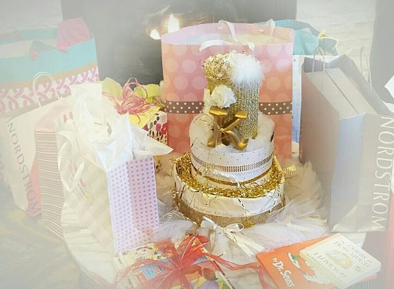 Let Tiers of Joy Diaper Cakes & Gifts create a centerpiece for your shower. It's sure to be a hit. Shop @ www.tiersofjoydiapercakes.com