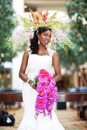 Eniola's cascading bouquet is a real scene-stealer. It's a traditional style of bouquet most popular with princesses and other modern day royal brides.