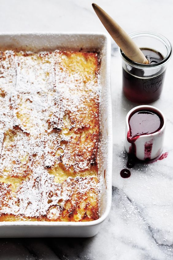 baked baguette french toast with blackberry sauce.
