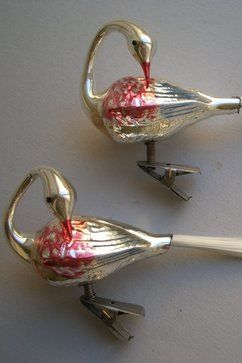 My Grandmother had German bird ornament along the same concept as these, except I think they were cardinals. An older Pin marks these as : Vintage Christmas Ornaments Blown Glass, Swans.