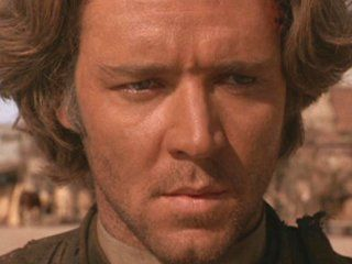 Cort (Crowe) in The Quick and the Dead--Gunslinger turned Priest