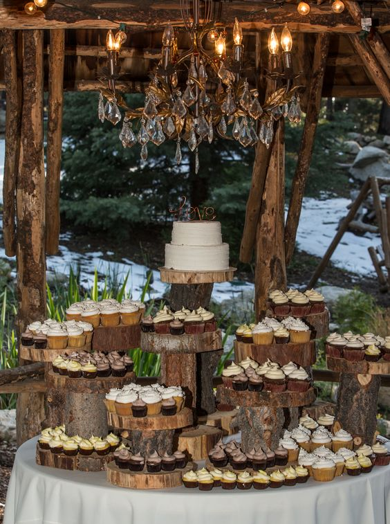 2 tiered wedding cake with cupcakes is an alternative to a multi-tiered cake at Hidden Creek Lodge. Love the rustic cake stand! #PineRoseWeddings