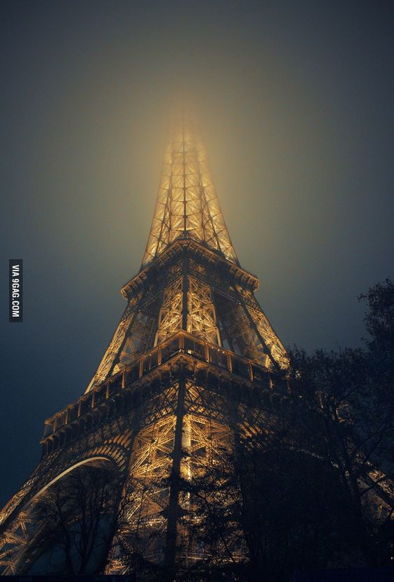 The view of Eiffel Tower in a foggy night