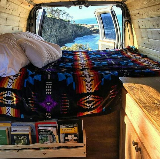 Van life-- I like the bed side book rack.