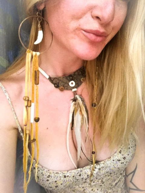 Single Gypsy Copper Hoop Earring with Coyote Tooth Elk Leather Tassels with Bone Beads. $30.00, via Etsy.
