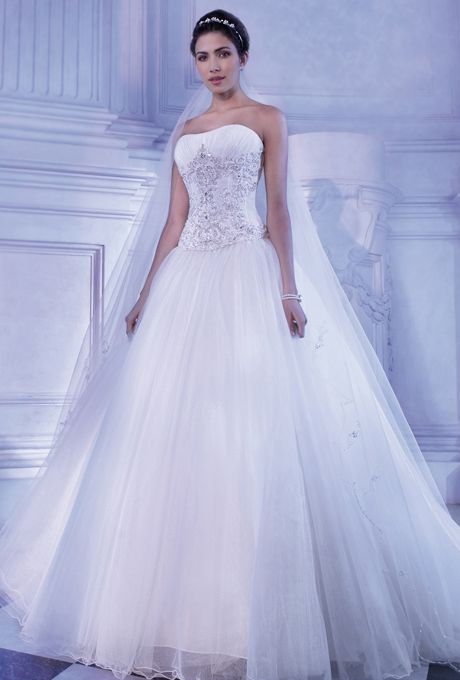 Brides: Demetrios - Young Sophisticates. Strapless tulle gown with a Basque waist, crystal jeweling and ruching on soft sweetheart bodice and lace-up back. Full, A-line skirt features a chapel length train.