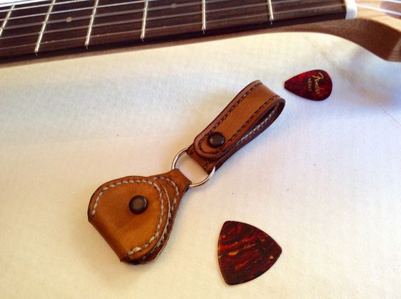 A personal favorite from my Etsy shop https://www.etsy.com/listing/259212988/guiter-pick-caddy-makes-a-perfect-gift