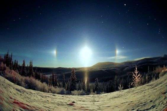 photos of 22º radius halos, which occur as the light from the sun or the moon, usually when close to the horizon