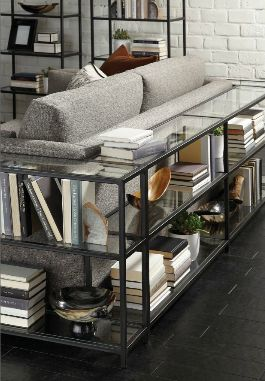 we like the open shelving behind the couch. main living room.   mitchell gold + bob williams
