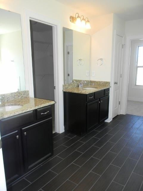 Love The Dark Tile Floors And Split Sinks In Front Of A Large Walk