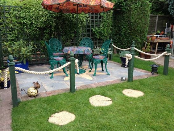 Rope fence ropes and decking on pinterest for Garden decking with rope
