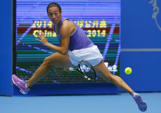 Francesca Schiavone of Italy returns a volley from between her legs during her women's singles match against Samantha Stosur of Australia at the China Open tennis tournament in Beijing September 28, 2014. REUTERS-Petar Kujundzic