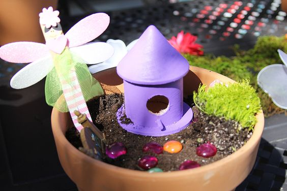 DIY fairy gardens - each with its own style and design.
