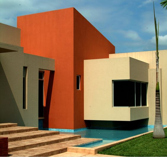 narancs, krém és szürke párosítása családi házon