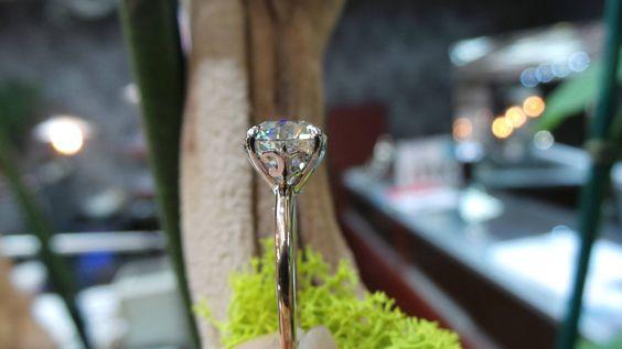 Antique-inspired fleur de lis solitaire by David Klass Jewelry.