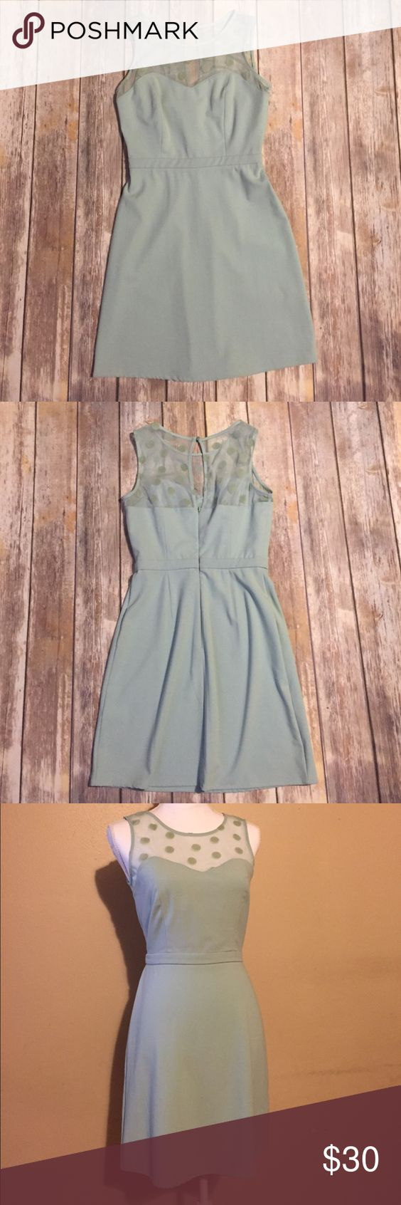 Lauren Conrad - Mint Green Dress with Polka Dots EUC -This will end up being your new favorite dress! It's a simple silhouette with an empire waist, sweetheart neckline and polka dot sheer top. The color is a light mint green. Zipper is located in the back. 58% polyester 35% rayon 7% spandex LC Lauren Conrad Dresses Midi