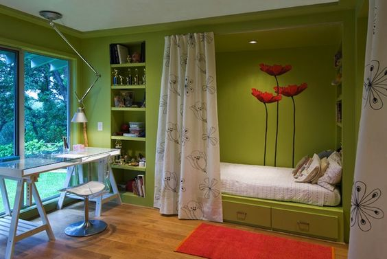 bold granny smith apple green walls paint color & built-in storage bed, sliding doors, glass-top sawhorse desk, modern acrylic chair, red orange rug & wall mural stickers.
