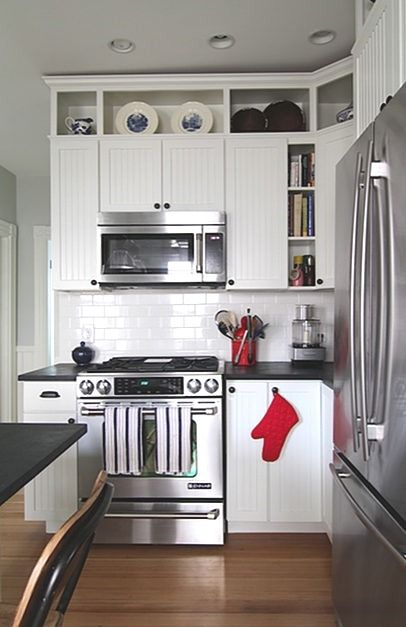 Kitchen cabinets extended with open shelving to the ...
