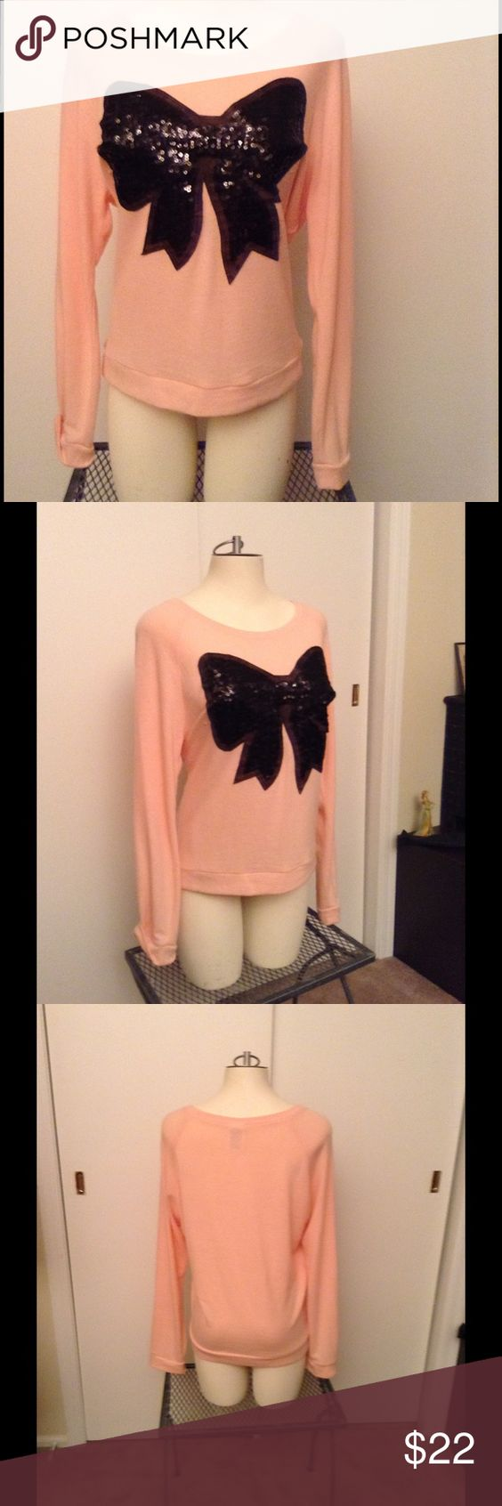Peach long sleeve blouse with black Sequin bow🎀 So soft & pretty, lightweight blouse, long sleeved, worn maybe twice, in excellent condition , has warm fuzzy material on the inside, perfect under a jean jacket, or black leather. Bought at Macy's in September . ML💗 Tops Blouses