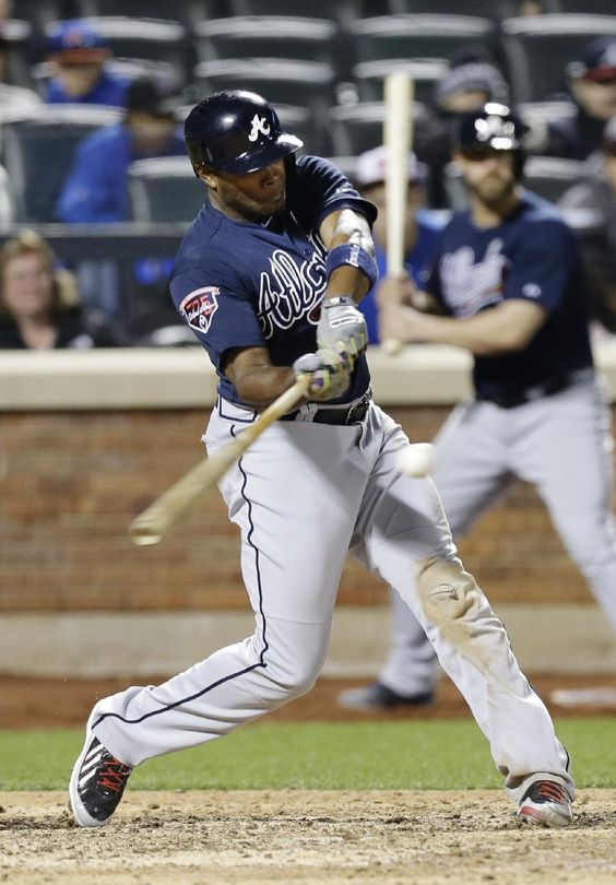 Atlanta Braves' Justin Upton hits a three-run home run in the ninth inning of a baseball game against the New York Mets.