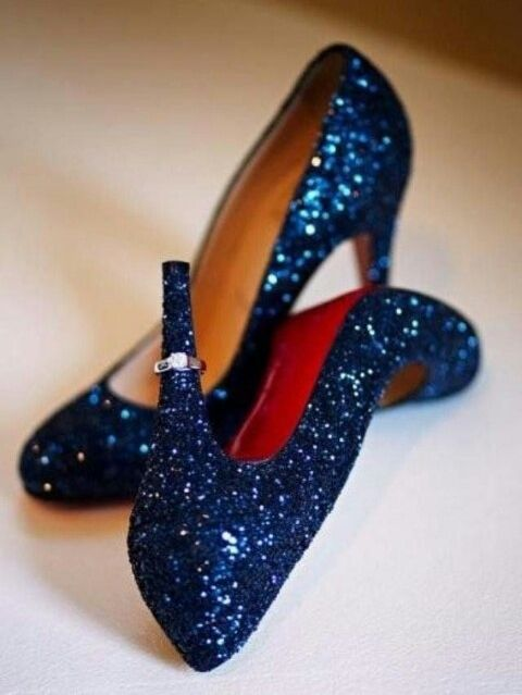 Gorgeous shoes for a midnight blue wedding to peek out from beneath a beautiful white gown