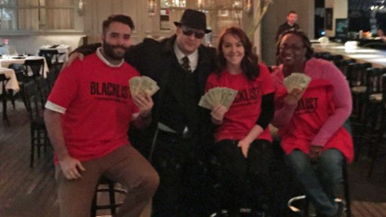 """Winners of the """"Red on the Run to Thursdays"""" scavanger hunt in Dallas Wednesday Grant Brandon, Clara Poole and Shaquinta Brewer are pictured with Red Reddington decoy at Hotel ZaZa."""