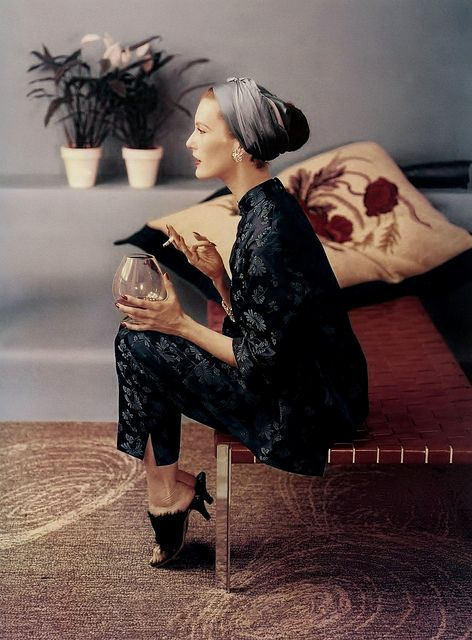 From the head scarf to the snifter of brandy, there is such a cool, avent-garde chicto this look. A 50s style that's still relevant.