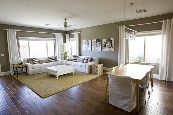 I want this living room - greige walls, natural fiber rug, long white curtains, square photos, striped pillows... excellent. (Other side of wall is fantastic too)