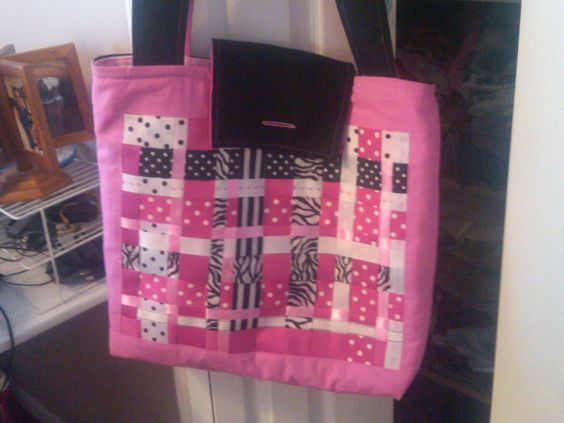 This tote bag was made for my niece. It is ribbon scraps woven and then I fused it to a stabilizer. She loved it