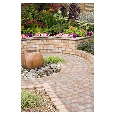 circular patio with brick raised bed seating and water feature mum gardengarden 2015garden - Brick Garden 2015