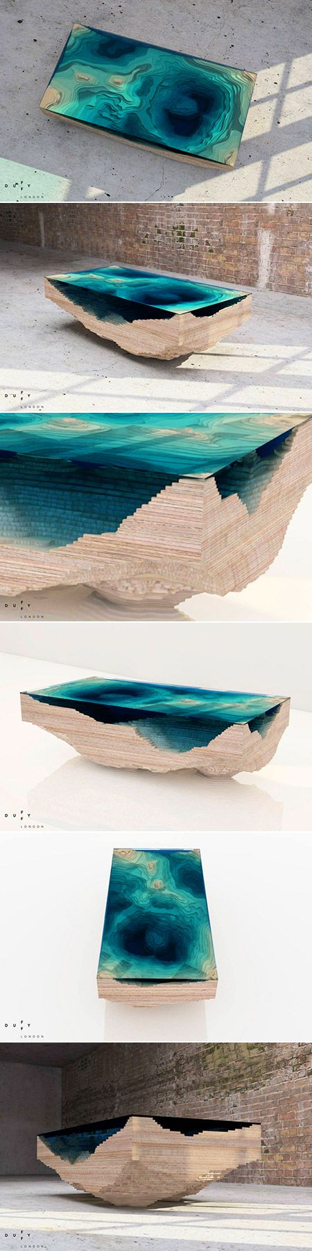 Glass table design by Duffy London - the Abyss table, which is created in a way that mimics the depths of the oceans. This unique table uses multiple layers of stacked glass and wood, completing the table as a three-dimensional representation of a geological map.