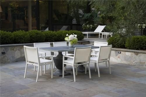 Enjoy dining alfresco on a classically beautiful table setting like this. Get more patio ideas here: http://www.landscapingnetwork.com/patios/styles.html Design of this landscape by The Garden Consultants in Highland Park, IL.