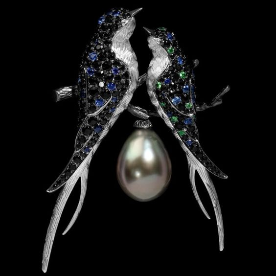 An emerald, sapphire, black diamond, pearl and white gold bird brooch, by Mousson Atelier.