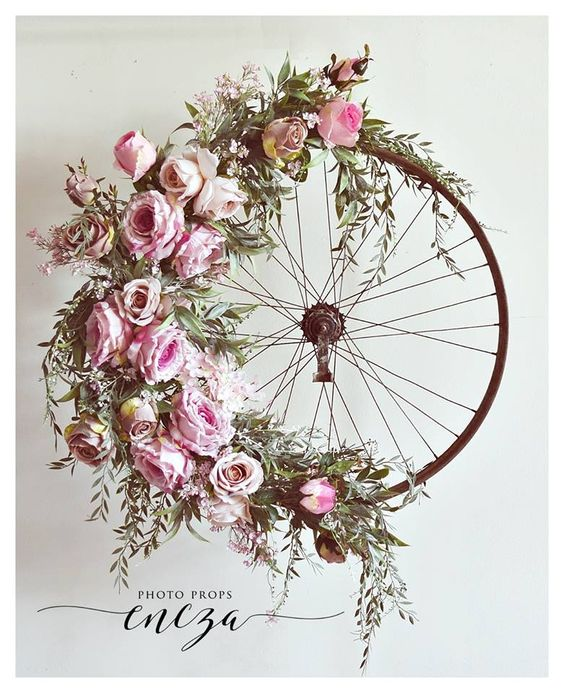 Bicycle Wheel Wreath-I so love the design if this wreath. Old tire frame just makes it for me