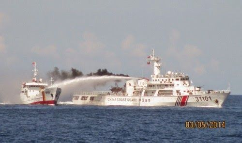 A Vietnamese boat is blasted with water cannons from a Chinese ship (R)   in Vietnam's waters in the East Sea