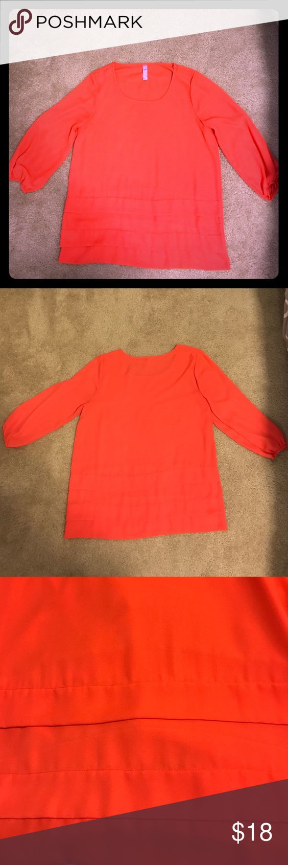 Pink 3/4 length sleeve blouse 100% polyester. Tiered detail at hem. Elastic sleeve cuffs. Great condition! Francesca's Collections Tops Blouses