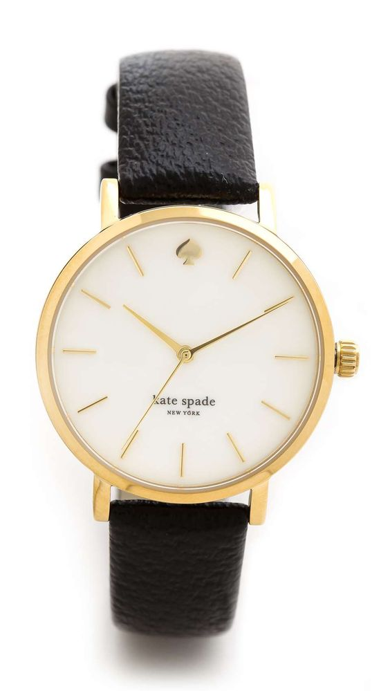Minimalist markers detail the round dial on this gold tone Kate Spade New York watch. Leather band. Adjustable length and buckle closure.  Water resistant to 30 meters. 2-year manufacturer warranty. Imported, China. MEASUREMENTS Dial: 1.25in / 3cm Band: 0.5in / 1.25cm Length: 6-8in / 15-20cm