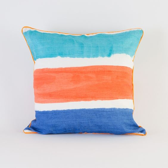 Hand painted coral and blue striped pillow by Bonnie and Neil. Not for shrinking violets...