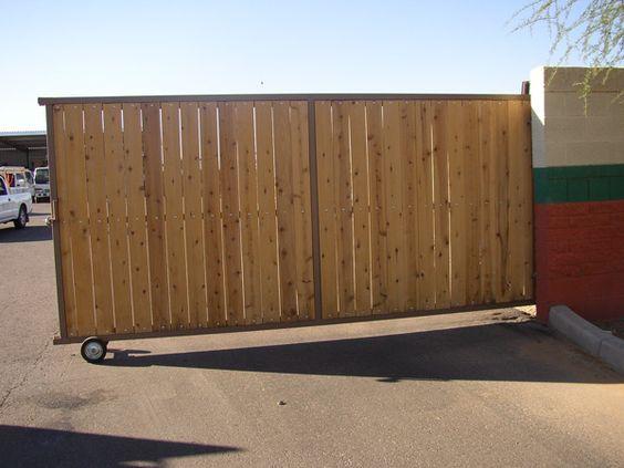 Driveway Gates A Rolling Driveway Gate With White Cedar