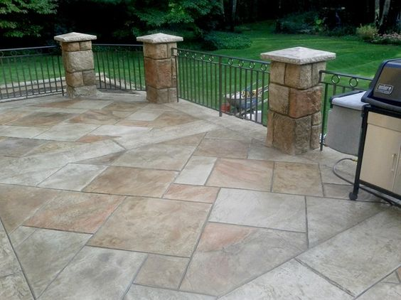 Love the color tones in this concrete too!! award winning stamped ...