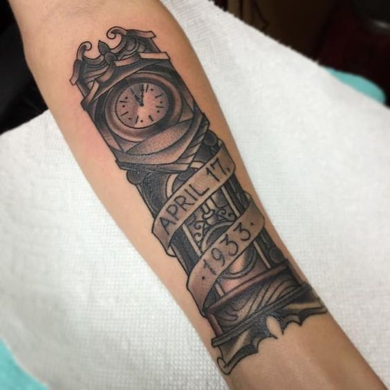 """Grandfather Clock with a date, could possibly do roman numerals and have the top """"line"""" be the date of birth and the bottom """"line"""" be the date of death."""