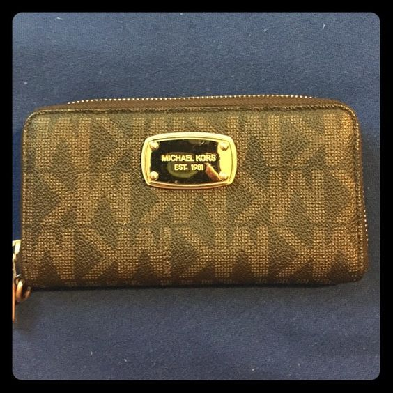 Michael Kors Wristlet Wristlet strap not included. Excellent condition! Love the durability of this brand. Perfect for carrying your phone. The iPhone 6 Plus does fit without a case or with a thin case. Michael Kors Bags Clutches & Wristlets