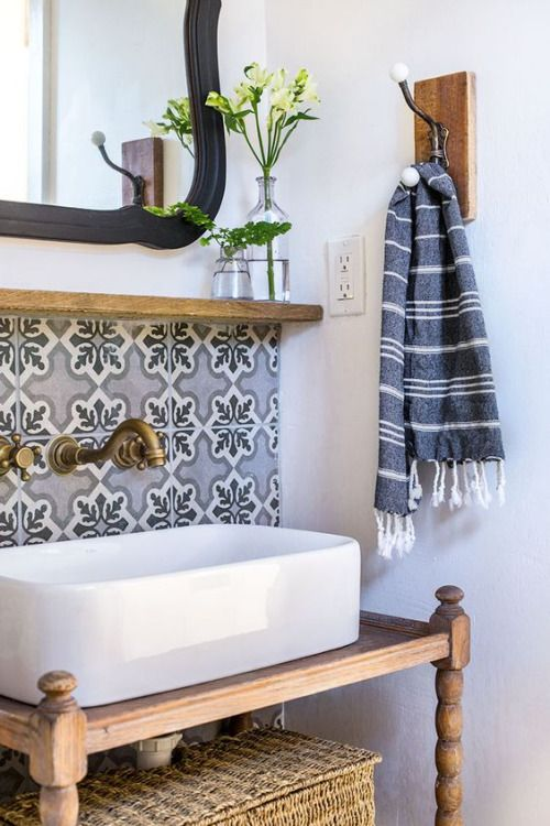Beautiful vessel sink on vintage wood vanity with brass wall mounted faucet. Come see more bathroom vanity inspiration! #modernfarmhouse #farmhousebathroom #jennasue #bathroomvanity